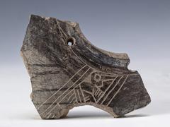 anthropomorphic representation on fragment of vessel, ancient art of ecuador - stock photo