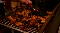 Cooking meat on the grill - chicken wings on fire Stock Footage