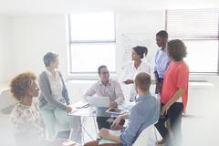 Group of business people having meeting in modern office - stock photo