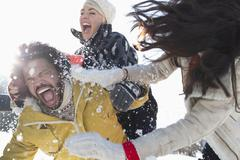 Friends enjoying snowball fight Kuvituskuvat