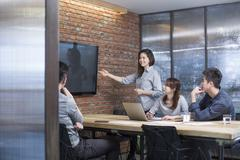 Business people having meeting in board room Stock Photos