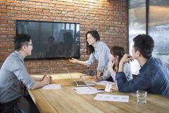 Business people having meeting in board room - stock photo