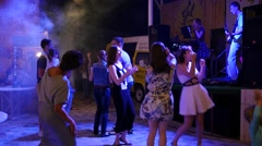 Stock Video Footage of Fun dance at night on open air fest at sea resort