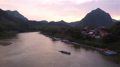 The Nam Ou river flowing in the remote Nong Khiaw in Laos Stock Footage