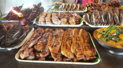 Diverse food at a Philippine market Stock Footage
