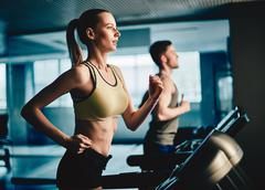 Workout on treadmill - stock photo