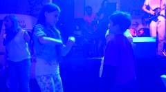 Kids fun dance at night on open air fest at sea resort Stock Footage