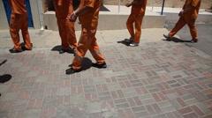Policemen evacuate prisoners from Carmel Prison Stock Footage