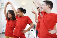 Stock Photo of Group Of Children Enjoying Drama Class Together