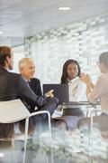 Business people talking in meeting in office building Stock Photos