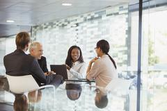 Business people talking in meeting in office building - stock photo