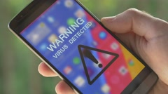 4K Warning Virus Detected Message on Smartphone Screen Stock Footage