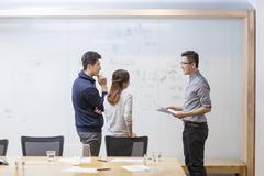 IT workers having a meeting in board room Stock Photos