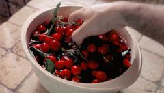 Cherries washing in bucket - stock footage