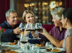 People toasting with red wine in restaurant Stock Photos