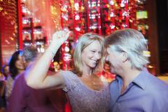 Mature couple dancing in night club Kuvituskuvat