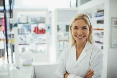 Pharmacist smiling in drugstore Stock Photos