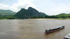 Boat on the Mekong river in Pak Ou, in Laos Stock Footage