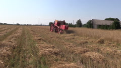 Harvester work barley corn field. Activities rural countryside Stock Footage