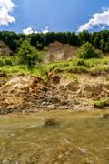 Riverbank on the River  showing signs of bank erosion and instability - stock photo