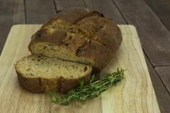 Loaf of wholemeal brown bread cut ready to serve - stock photo