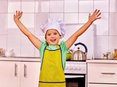 Child cooking at kitchen - stock photo