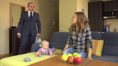 Nanny lay on sofa near baby. Angry father man in suit. 4K Stock Footage