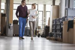 Business people walking in office - stock photo