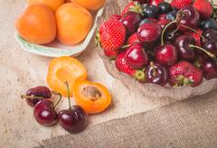 fresh apricots and berries - stock photo