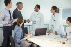 Scientists and business people talking in conference room - stock photo