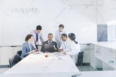 Scientists and business people talking in conference room Stock Photos