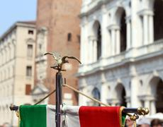italian flag of army musical band and the Palladian Basilica - stock photo