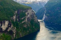 Turn of Geirangerfjord near craggy rocks Stock Photos