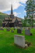 Old wooden stave chapel surrounded by cemetery, Norway Stock Photos
