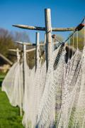 Closeup view on vintage fishing net - stock photo