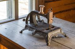 Old vintage sewing machine on wooden table Stock Photos