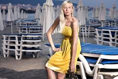 Young attractive blond beauty on beach - stock photo