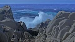 Shades of Blue Sea and Granite Rock Capo Testa Sardinia Italy - 25FPS PAL Stock Footage