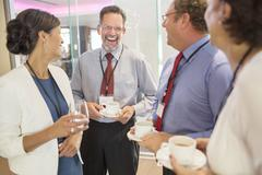 People in lobby of conference center during coffee break Stock Photos