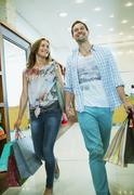 Stock Photo of Couple shopping together in store