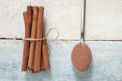 Some cinnamon sticks tied with a natural rope. Stock Photos