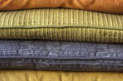 Stack of colorful cushions - stock photo