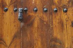 Old wooden door with latch - stock photo