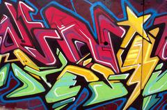 Urban art. Detail of an graffiti on wall. Stock Photos