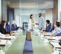 Business people shaking hands in conference room during business meeting - stock photo