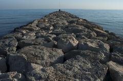 Breakwater in Sitges, Catalonia, Spain. Stock Photos