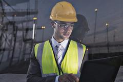 Businessman wearing protective workwear near window - stock photo