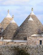 Murge  Puglia, Italy  - Characteristic trulli near countryside Alberobello - stock photo