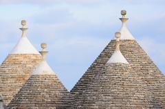 Murge  Puglia, Italy  - Characteristic trulli near countryside Alberobello - stock photo