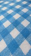 Picnic tablecloth, blue background - stock photo